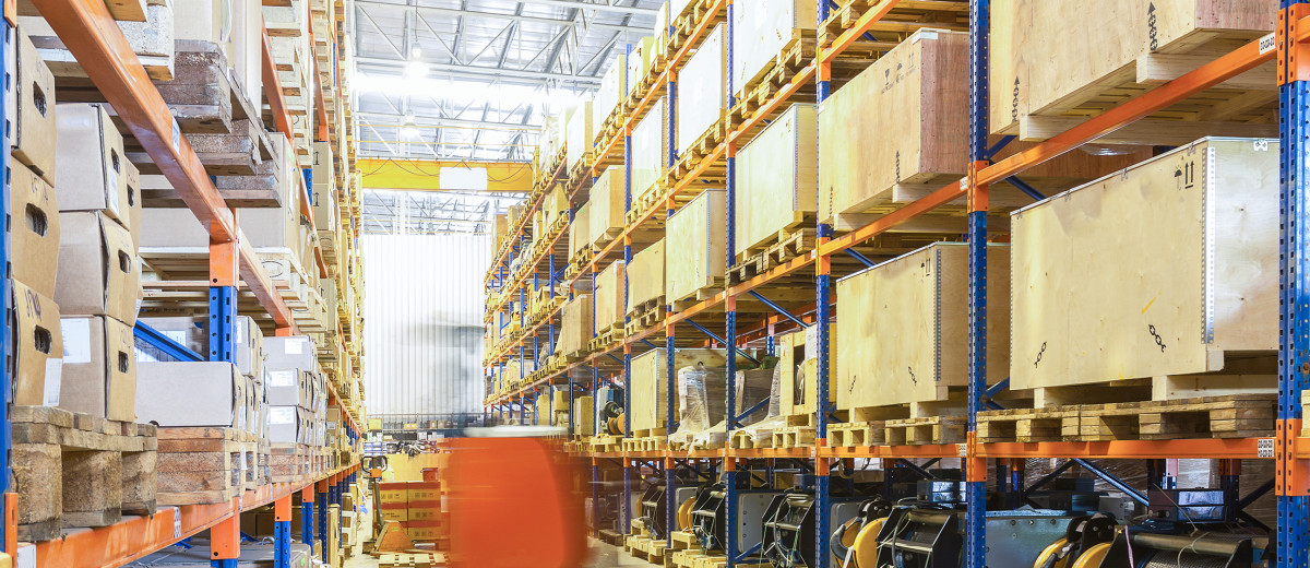 Large modern warehouse with moving forklifts